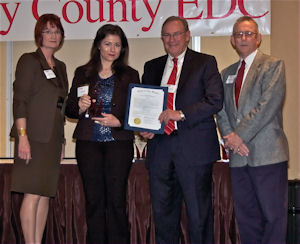 Rockwell Labs CEO Dr. Cisse Spragins, second from left, receives the Keystone Award from the Clay County Economic Development Council.