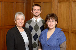 Dr. Linda Mason, Purdue University entomology professor, congratulates Jeff Trembacki and Susanna Sisk.