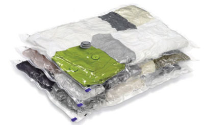 Vacuum Storage Bag Containing Bed Bug Infested Clothes Before Pouch Of Dry Ice