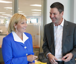 Marathon Data Systems CEO Chris Sullens and New Jersey Acting Governor Kim Guadagno share a candid moment during the ribbon-cutting ceremony.