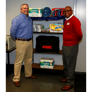 Univar's Kevin Behrens, left, and FMC's Arnold Ramsey stand with a sampling of the supplies donated by the Ohio pest management community for homeless men and women in the state. PHOTO CREDIT: DaJo Photography