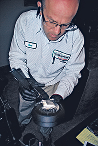 Geherty places a dead bed bug discovered during inspection into an interception device for examination.