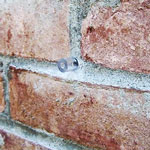 chemical injection port in brick