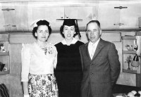 Dr. Hansen with her parents at her 1962 graduation ceremony at Eastern Washington University.