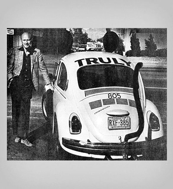 Truly David Nolen stands with the 1961 VW Beetle that started the Mouse Car fleet — a company tradition that continues today with modern Beetles, and permeates the company's marketing, logo, etc.