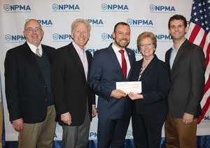 The NPMA's Dr. Jim Fredericks receives the NPMA Foundation check from Copesan President Deni Naumann. From left are Dr. Jim Sargent, Copesan; Alfie Treleven, Sprague Pest Solutions; Fredericks, Naumann, and Dr. Bennett Jordan, Copesan.