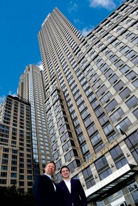 Aust and his son Dan stand in front of another big-ticket account, Trump Place. Photo: Fred Miller, fmfotofm@aol.com