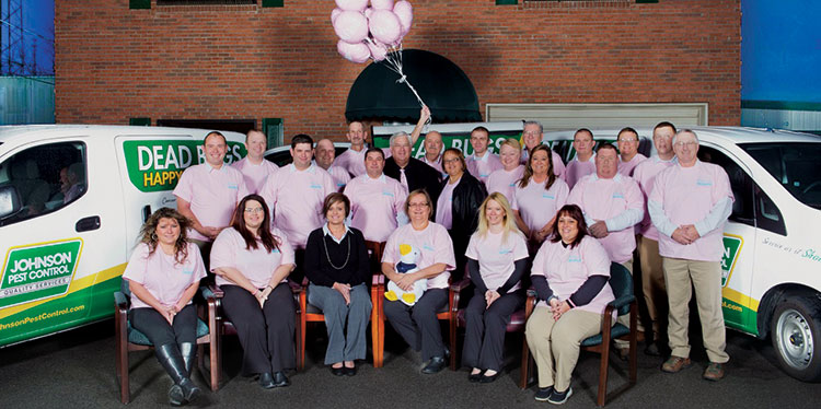 Johnson Pest Control's Donna Coker (front row center, holding duck) inspired a cancer awareness campaign that's showcased on the company's trucks. Photos: Johnson Pest Control