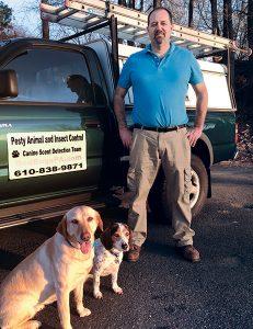 From left are Holly, Faith and their handler, Glenn Holschwander. Photo: Pesty Animal & Insect Control