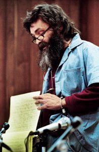 Charles Manson reads a statement at his 1986 parole hearing in San Quentin. Photo: ©corbis.com/Bettmann