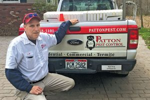 """J.R. Walsh shows off """"the bug whisperer"""" bumper sticker a co-worker put on his truck. Photo: Heather Gooch"""