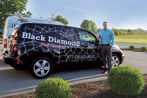 Black Diamond's Keith Duncan Jr. and his custom-wrapped vehicles. Photo: black diamond Pest controL