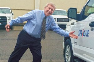 Treleven jokes around in the Sprague home office parking lot.  Photo: Larry Treleven