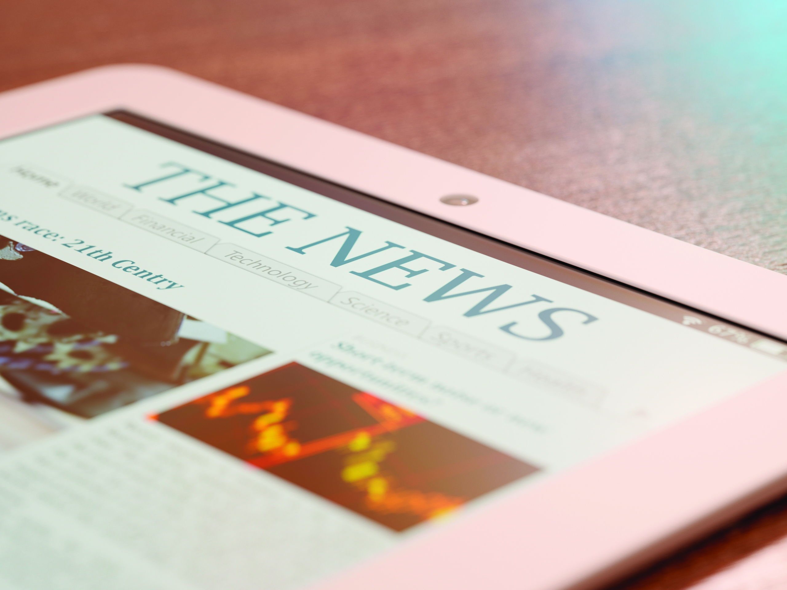 Tablet PC with newspaper app close-up