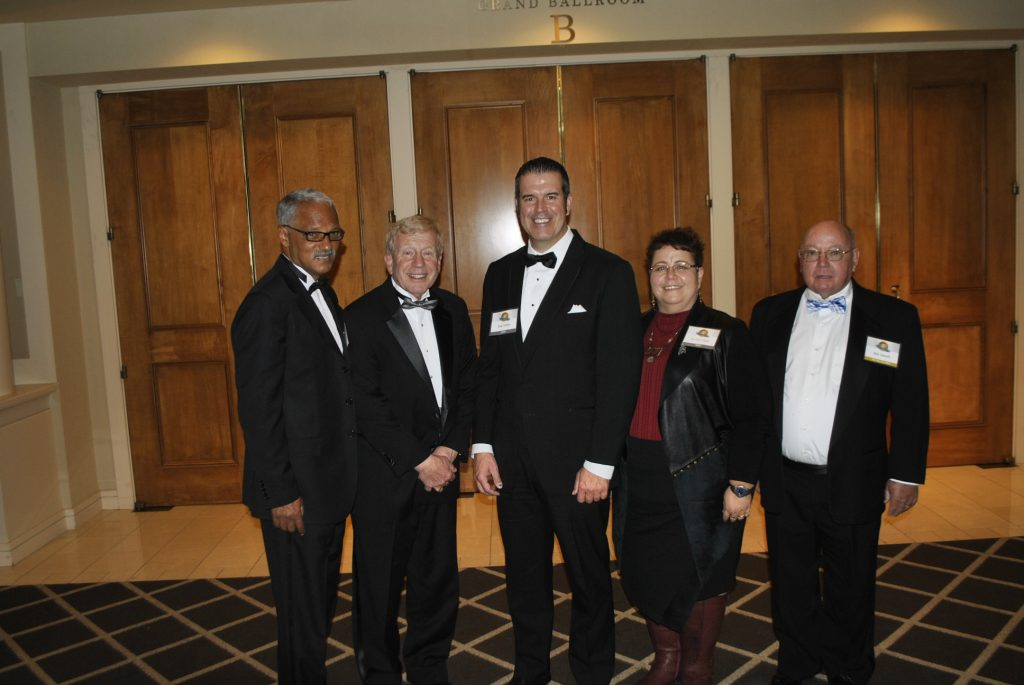The PMP Hall of Fame induction ceremony for the Class of 2016 included, from left to right, Dr. Vernard Lewis; Larry Treleven; Blair and Brenna Toblan, who accepted the honor on behalf of their father, the late Vern Toblan; and Dick Sameth. Photo: PMP