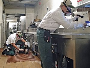 Restaurant jobs often require a PMP to get down and dirty on their knees. As with most jobs, gloves and a flashlight are essential. Photo: Terminix Service Co.