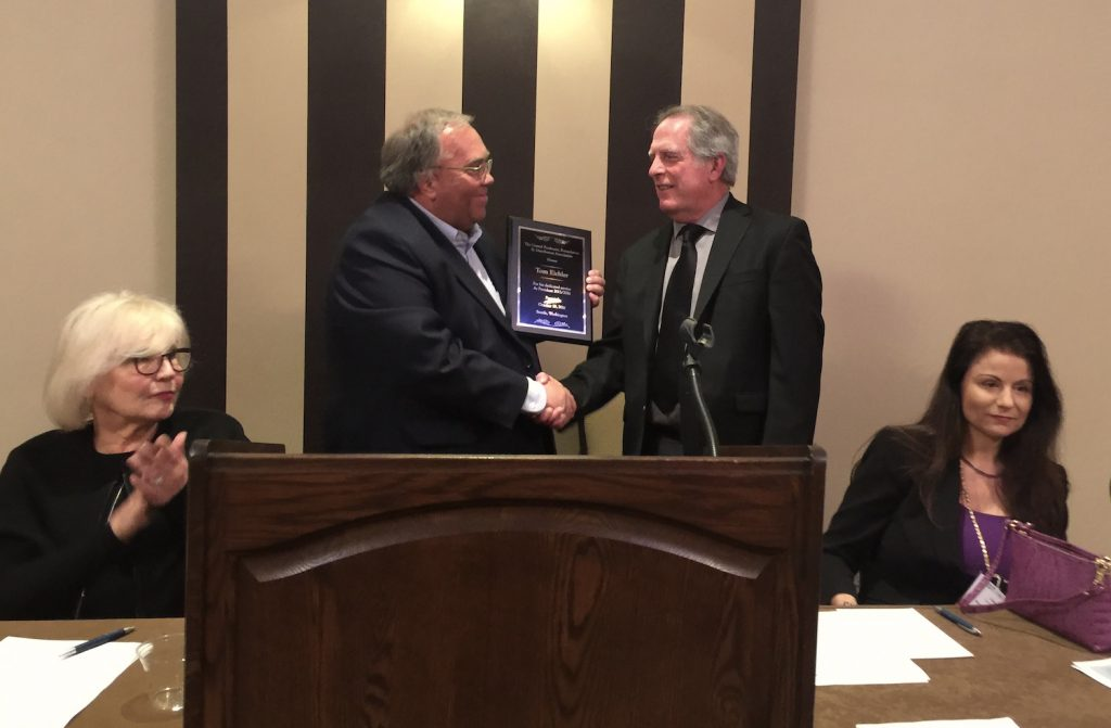 Tommy Reeves, left, presents Tom Eichler with an award for his service as the 2016 president of UPFDA.