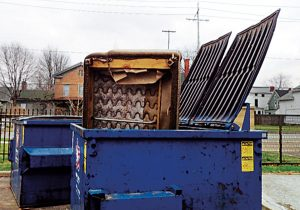 Visible furniture in the dumpster often doesn't remain there. Photo: Mark Sheperdigian