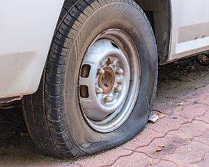 is-477943536-flat-tire