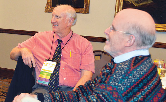 Purdue's Dr. Gary Bennett (left) and Boilermaker-turned-consultant Dr. Bobby Corrigan, both PMP Hall of Famers, shared a laugh at the Pi Chi Omega meeting.