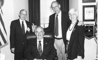 Roland Rhodes, seated, is surrounded by (from left) Hall of Famer Vernon McKinzie (Class of 2013), Sen. Pat Roberts (R-Kan.) and Nancy McKinzie.'Photo: Courtesy of Deborah Ball