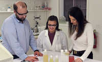 Rockwell Labs Chemistry Manager Todd Fleischmann and student intern Kathryn Monahan discuss a new formulation with Dr. Cisse Spragins. (Photo courtesy of Rockwell Labs)