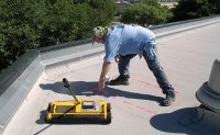 Don Putnam, an Austin, Texas-based construction consultant, performs a roof moisture survey using a Tramex Dec Scanner. Photo: Putnam Construction Consulting