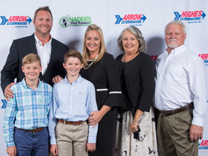 Shay Runion, center, is flanked by her husband, sons and parents. PHOTO: ARROW EXTERMINATORS