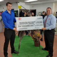 John Cambridge, owner of the Philadelphia Insectarium & Butterfly Pavilion, left, receives the check from Orkin Region Sales Manager David McDeavitt. PHOTO: ORKIN