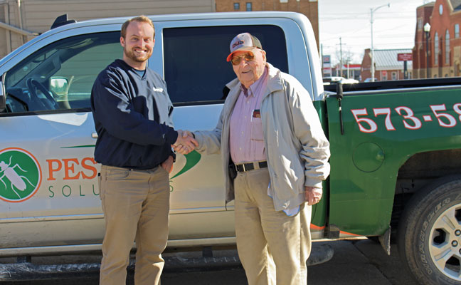 Michael Patterson, left, shakes hands with Dub Hayes to close their business deal. PHOTO: MICHAEL PATTERSON