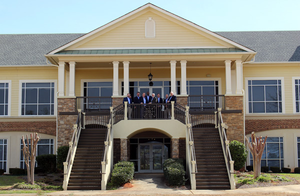 Active's leadership team stands on the balcony of the new headquarters. PHOTO: ACTIVE PEST CONTROL