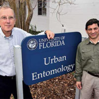 Drs. Koehler and Roberto Pereira stand in front of their home base at the University of Florida: the Urban Entomology building.Photo: PMP, 2015