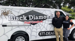 Franchise owners Nick Vonella and Ashley Naumann stand in front of their new company vehicle at Black Diamond Pest Control in Pinellas County, Fla. PHOTO: BLACK DIAMOND PEST CONTROL