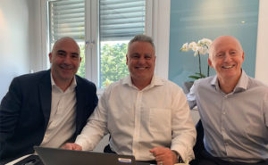 From left are Paul Giannamore of Potomac; Tony DiLucente, CFO of ServiceMaster; and Svein Olav Stölen, CEO of Nomor. PHOTO: THE POTOMAC CO.