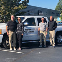 From left are Dayton and Sheila Hylton, Waynes President Eric Frye, and Shawn Hollis of Waynes. PHOTO: WAYNES PEST CONTROL