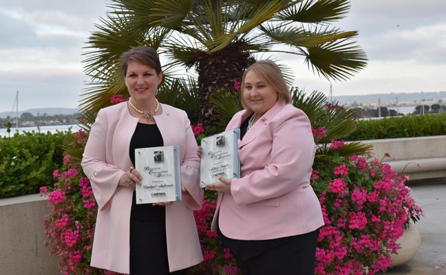 Bridget Anderson, Ecolab, and Ashley Sands, Future Services, receive the 2019 PWIPM Professional Empowerment Grant at PestWorld. PHOTO: DANIELLE PESTA