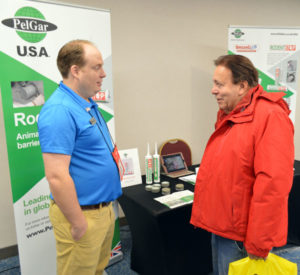 Andrej Branc, PelGar International's Americas Business Manager, discussing RodentStop at the 2019 New York Pest Expo. PHOTO: MARTY WHITFORD