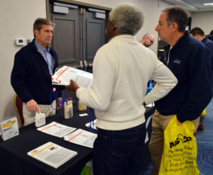 Brian Cooney with MGK discusses CrossFire and . Decimari with New York Pest Expo attendees. PHOTO: MARTY WHITFORD