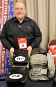 Craig Martelle, the Northeast Sales Manager for J.T. Eaton, demonstrates the product along with a PMP magnet! PHOTO: MARTY WHITFORD