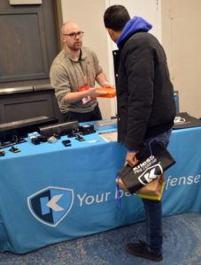 Joseph Belcher, Western US sales manager with Kness Manufacturing, shares information about the company's release of Krittersense. PHOTO: MARTY WHITFORD