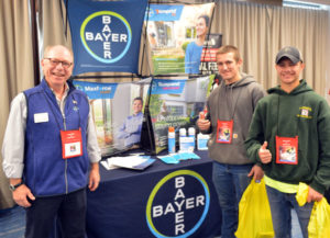 Kevin Connally, Northeast Area Sales Manager with Bayer, stands with New York Pest Expo attendees. PHOTO: MARTY WHITFORD