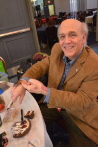Lou Sorkin, BCE, shows off a cockroach among many other pests he brought to the 2019 New York Pest Expo for attendees to check out. PHOTO: MARTY WHITFORD