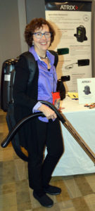 Mary-Shea Murphy, the Business Development Manager with Atrix International, demonstrates one of the company's ultrafine filtration vacuums. PHOTO: MARTY WHITFORD