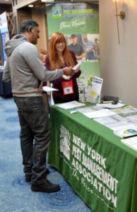 Attendees at the New York Pest Expo visited the New York Pest Management Association booth for information on upcoming regulatory matters. PHOTO: MARTY WHITFORD