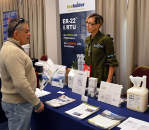 Vicki Holst, Reneotech Territory Rep, discussing Ecoraider with attendees at the 2019 New York Pest Expo. PHOTO: MARTY WHITFORD