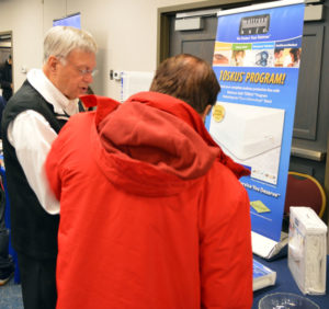 Will Poston, CEO of MattressSafe talks with an attendee at the 2019 New York Pest Expo. PHOTO: MARTY WHITFORD