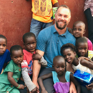 Kyle Finley with Ugandan children. PHOTO: KYLE FINLEY