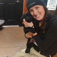 Paula Lomax and one of the pups in training just months after birth. PHOTO: BLACK DIAMOND PEST CONTROL