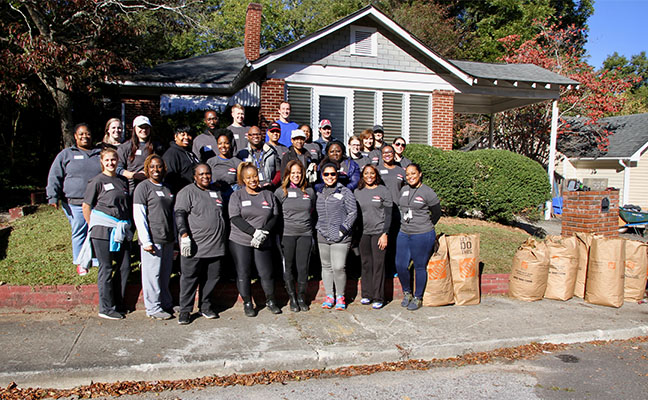 Rollins employees gather for a picture in the Grove Park community after completing their day of service. PHOTO: ROLLINS INC.