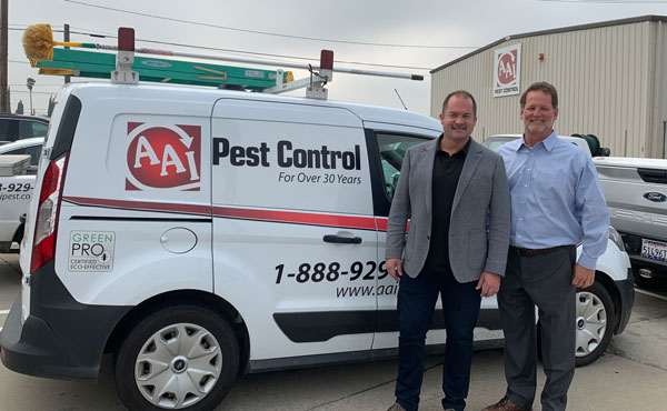 Ben Miller, left, owner of AAI Pest Control, stands next to Kemp Anderson, right. PHOTO: KEMP ANDERSON CONSULTING